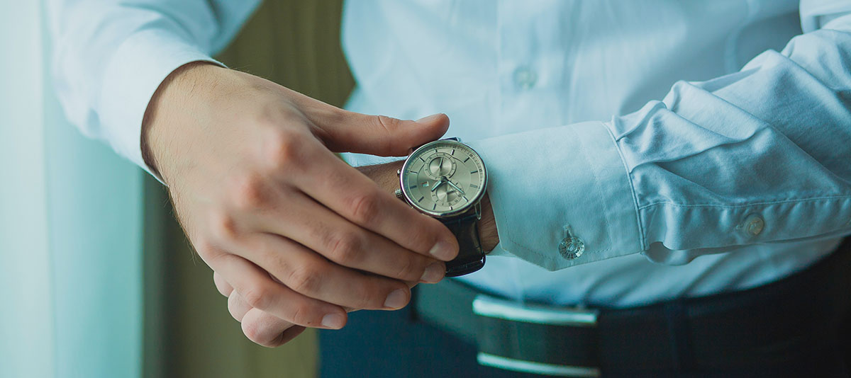 A person looking at his/her watch.